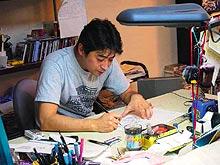 Kazuki Takahashi working in his studio.
