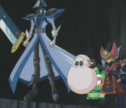 """Silent Swordsman LV0"" and ""Silent Magician LV0"" with Yugi Muto and ""Marshmallon""."