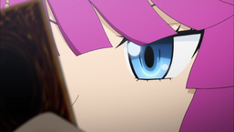 Romin looks at her Duel Monsters card.