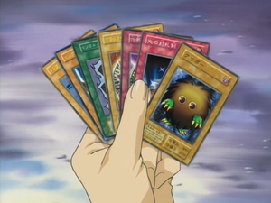 A hand of cards in the second series anime.