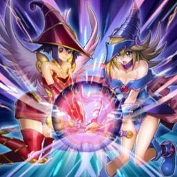 """Apple Magician Girl"" and ""Dark Magician Girl"" in the artwork of ""Magicians' Defense""."
