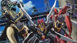 "Yusei Fudo with ""Nitro Warrior"", ""Road Warrior"", ""Turbo Warrior"" and ""Junk Warrior"", as well as ""Junk Destroyer"" in the center."